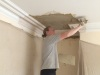 plasterer starting on lath ceiling and cornice repair