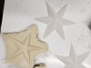 The rubber mould that was created and the plaster star shape it makes.