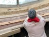 Our craftsman at work, preparing the area for running the cornice after plasterwork restoration