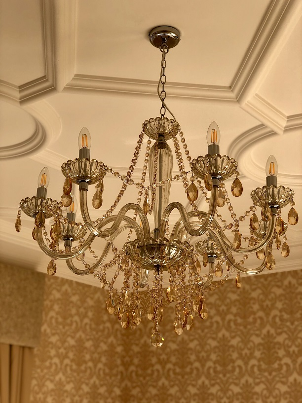 decorative plaster strapwork ceiling with chandelier