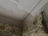 New cornice replacing water damaged section and its finish next to the original cornice.