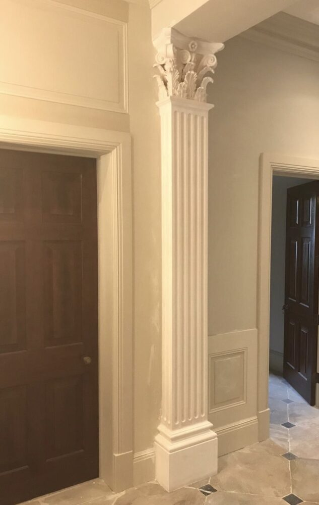 One corinthian column in-situ, with elaborate capital with characteristic embellishment of acanthus leaves and scrolls